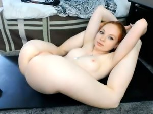 Redhead is removing her clothes