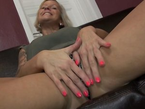 Hot German housewife masturbating on her couch