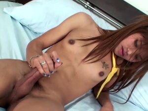 Feminine femboy with beautiful hair pops out huge shecock