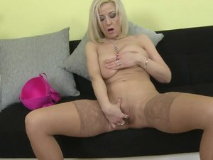 Cute housewife masturbating on her couch