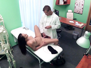 Doctor Examines Patient with Cock
