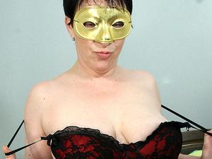 Masked mature slut getting herself wet