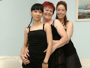Three old and young lesbians playing on the couch