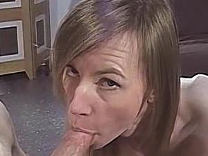 Skinny milf strips nude then sucks a big hard cock
