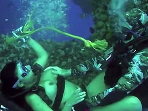 Fucking this busty cutie underwater while scuba diving