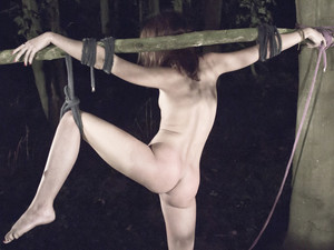 Russian girl restrained in the dark woods for fuck