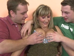 Horny big breasted housewife in a steamy threesome