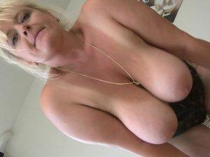 Bug breasted mature slut getting wet
