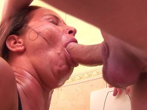 Horny mature toilet slut pissing and gagging on cock