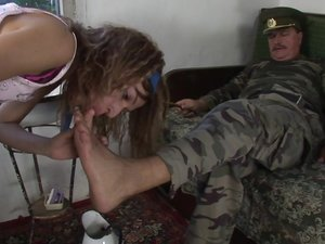 Young girl taking orders from an old sarge