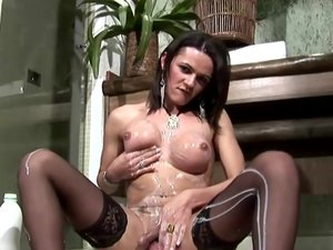 Raunchy brunette tranny in stockings shows off massive ass